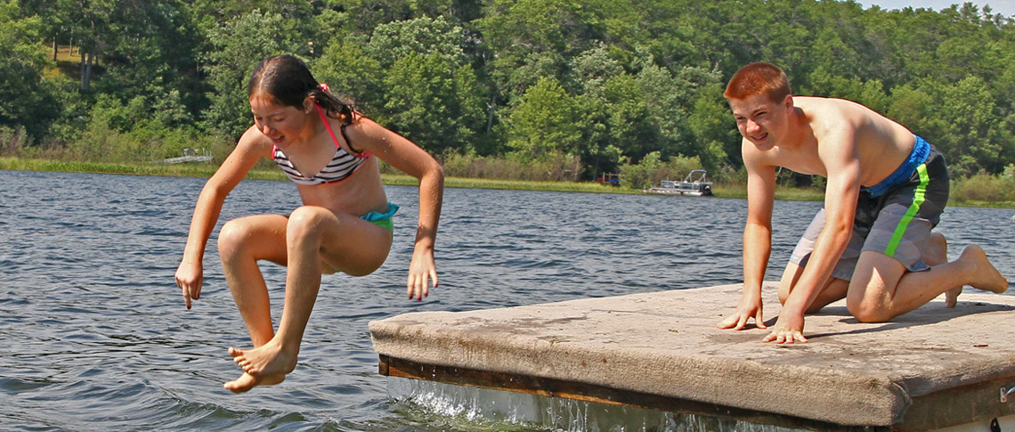 Jumping off dock swimming